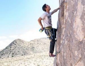 man rock climbing desert