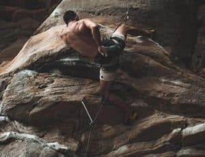 strong man rock climbing