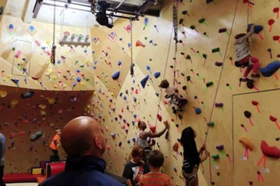 children rock climbing indoors