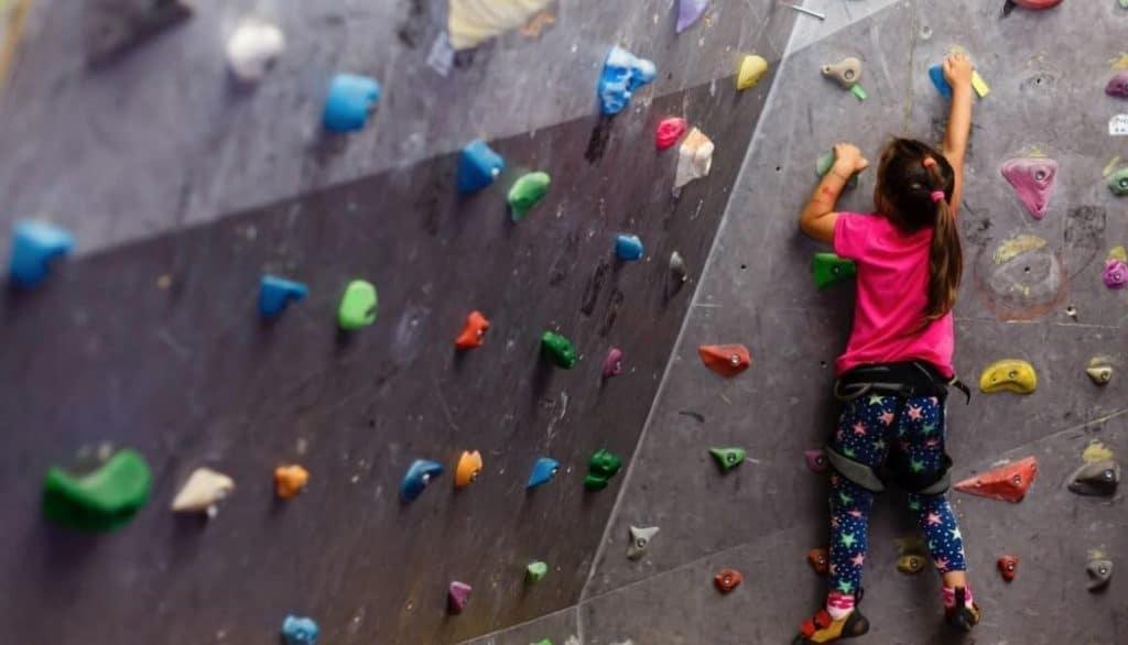 girl rock climbing indoors